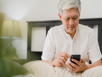 Source: freepik; Copyright: tirachardz; URL: https://www.freepik.com/free-photo/asian-senior-men-using-mobile-phone-home-asian-senior-chinese-male-search-information-about-how-good-health-internet-while-lying-bed-bedroom-home-morning-concept_5820713.htm#page=2&query=patient+in+bed&position=9; License: Licensed by JMIR.