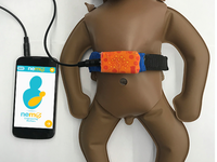 NeMo band and smartphone app on a NeoNatalie inflatable simulator. Source: Image created by the Authors; Copyright: The Authors; URL: https://mhealth.jmir.org/2019/8/e14540/; License: Creative Commons Attribution (CC-BY).