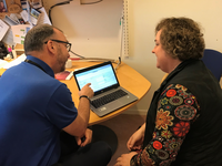 Nurse showing patient a website. Source: Image created by the Authors; Copyright: The Authors; URL: https://nursing.jmir.org/2019/1/e14194/; License: Creative Commons Attribution (CC-BY).