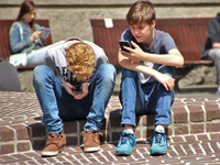 Source: Pexels; Copyright: Pixabay; URL: https://www.pexels.com/photo/2-boy-sitting-on-brown-floor-while-using-their-smartphone-near-woman-siiting-on-bench-using-smartphone-during-daytime-159395/; License: Licensed by JMIR.