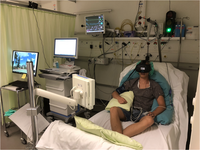 Subject during the stimulation in a VR environment, including the whole setup. Source: Image created by Authors; Copyright: The Authors; URL: https://periop.jmir.org/2019/2/e15579; License: Creative Commons Attribution (CC-BY).