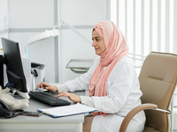 Source: Adobe Stock; Copyright: Seventyfour; URL: https://stock.adobe.com/ca/images/portrait-of-young-middle-eastern-woman-wearing-hijab-working-as-nurse-in-medical-clinic-and-using-computer-at-workplace-copy-space/289855567?asset_id=289855567; License: Licensed by JMIR.