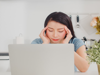 Source: freepik; Copyright: tirachardz; URL: https://www.freepik.com/free-photo/young-asian-business-woman-records-income-expenses-home-lady-worried-serious-stress-while-using-laptop-record-budget-tax-financial-document-working-modern-kitchen-house_6142449.htm#page=1&query=asian%20person%20using%20c; License: Licensed by JMIR.