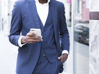Source: freepik; Copyright: freepik; URL: https://www.freepik.com/free-photo/african-young-businessman-with-his-hands-his-pocket-using-mobile-phone_4765057.htm; License: Licensed by JMIR.