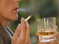Source: iStock by Getty Images; Copyright: Buenaventuramariano; URL: https://www.istockphoto.com/photo/woman-drinking-a-glass-of-whiskey-and-smoking-a-cigarette-gm902089248-248848516; License: Licensed by the authors.