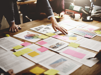 Several files that can be used to document and reflect on a development process. Source: Shutterstock; Copyright: Rawpixel.com; URL: https://www.shutterstock.com/image-photo/business-people-meeting-design-ideas-concept-362158346; License: Licensed by the authors.