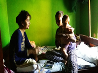 Counselor using the StandStrong app during a psychosocial counseling session with a young adolescent mother. Source: Image created by the Authors; Copyright: The Authors; URL: https://www.researchprotocols.org/2019/9/e14734/; License: Creative Commons Attribution (CC-BY).