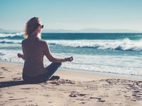 Woman meditating on the beach. Source: Pond5; Copyright: amoklv; URL: https://www.pond5.com/photo/36944784/young-woman-meditating-beach.html; License: Licensed by the authors.