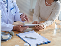 Source: freepik; Copyright: pressfoto; URL: https://www.freepik.com/free-photo/discussing-records-with-senior-patient_5633825.htm#page=1&query=doctor+using+tablet&positio; License: Licensed by JMIR.