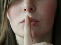 Source: Max Pixel; Copyright: Max Pixel; URL: https://www.maxpixel.net/Girl-Female-Woman-Secret-Young-Finger-Face-Lips-2725302; License: Public Domain (CC0).