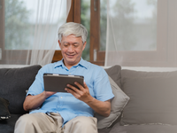 Source: Freepik; Copyright: tirachardz; URL: https://www.freepik.com/free-photo/asian-senior-men-using-tablet-home-asian-senior-chinese-male-search-information-about-how-good-health-internet-while-lying-sofa-living-room-home-concept_5820821.htm#page=1&query=elderly%20technology&position=37; License: Licensed by JMIR.