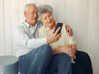 Source: freepik; Copyright: prostooleh; URL: https://www.freepik.com/free-photo/elegant-old-couple-sitting-home-using-phone_6633782.htm#page=1&query=elderly%20smartphone&position=3; License: Licensed by JMIR.