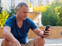 Source: Freepik; Copyright: Dragana_Gordic; URL: https://www.freepik.com/free-photo/close-up-portrait-happy-smiling-forty-years-old-caucasian-man-talking-mobile-phone-outdoor_1190307.htm#page=1&query=middle%20aged%20man%20with%20phone&position=42; License: Licensed by the authors.