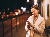 Source: freepik; Copyright: senivpetro; URL: https://www.freepik.com/free-photo/young-woman-using-phone-outside-night-street_5852125.htm#page=1&query=woman%20using%20smartphone&position=27; License: Licensed by JMIR.