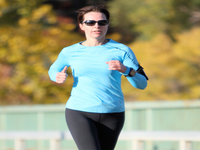 Woman running with fitness tracker. Source: Flickr; Copyright: Sangudo; URL: https://www.flickr.com/photos/23743320@N03/6317258485; License: Creative Commons Attribution + Noncommercial + NoDerivatives (CC-BY-NC-ND).