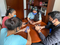 Students wearing masks to signify the COVID-19 situation, and using their phones (in particular, WhatsApp). Source: Image created by the authors; Copyright: Jean CJ Liu; URL: http://www.jmir.org/2020/9/e22142/; License: Creative Commons Attribution (CC-BY).