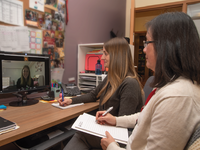 A physical therapist and an occupational therapist in a telerehabilitation meeting with a youth. Source: Shriners Hospitals for Children — Canada; Copyright: Shriners Hospitals for Children — Canada; URL: http://www.researchprotocols.org/2020/6/e18688/; License: Creative Commons Attribution (CC-BY).
