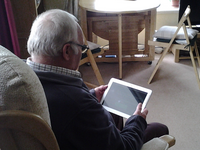 Tablet computer being used at home. Source: Image created by the Authors; Copyright: The Authors; URL: http://mhealth.jmir.org/2019/11/e14946/; License: Creative Commons Attribution + Noncommercial + NoDerivatives (CC-BY-NC-ND).