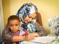 Mother completing information giving and consent process with her child. Source: Image created by the Authors; Copyright: The Authors; URL: http://www.researchprotocols.org/2020/4/e16531/; License: Creative Commons Attribution (CC-BY).