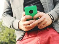 Young man holding a mobile phone. Source: pixabay; Copyright: JESHOOTS-com; URL: https://pixabay.com/photos/mobile-hand-nokia-lumia-man-young-722946/; License: Public Domain (CC0).