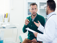 Professional consultation. Source: freepik; Copyright: pressfoto; URL: https://www.freepik.com/free-photo/professional-consultation_5402287.htm#page=2&query=patient+doctor+talking&position=1; License: Licensed by JMIR.