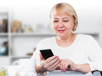 Woman accessing the virtual multidisciplinary care program. Source: Shutterstock; Copyright: Cricket Health; URL: https://www.shutterstock.com/image-photo/mature-woman-sitting-table-home-looking-1052671529; License: Licensed by the authors.