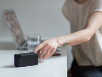 Source: https://www.pexels.com/; Copyright: Burst; URL: https://www.pexels.com/photo/woman-reaching-for-black-bluetooth-speaker-on-top-of-white-table-374056/; License: Licensed by the authors.