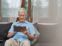 Source: freepik; Copyright: tirachardz; URL: https://www.freepik.com/free-photo/asian-senior-men-using-tablet-home-asian-senior-chinese-male-search-information-about-how-good-health-internet-while-lying-sofa-living-room-home-concept_5820821.htm#page=2&query=asian+person+computer&position=40; License: Licensed by JMIR.