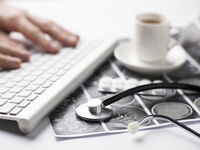 Source: freepik; Copyright: freepik; URL: https://www.freepik.com/free-photo/person-s-hand-typing-keyboard-near-ultrasound-scan-report-blister-pills-coffee-cup-desk_5234422.htm#page=2&query=doctor+with+laptop&position=44; License: Licensed by JMIR.