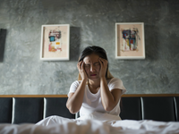 Source: Freepik; Copyright: jcomp; URL: https://www.freepik.com/free-photo/depressed-woman-with-headache-hand-holding-her-head-bed_2887270.htm#page=1&query=insomnia&position=2; License: Licensed by JMIR.
