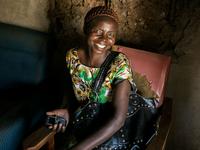 Woman using a mobile phone in Bondo, Kenya. Source: Paul J. Brown; Copyright: Paul J. Brown; URL: http://mhealth.jmir.org/2020/3/e15281/; License: Licensed by the authors.