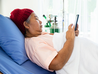 Source: Freepik; Copyright: jcomp; URL: https://www.freepik.com/free-photo/elderly-female-used-smartphone-patient-bed-hospital_7361537.htm#page=1&query=woman%20sick%20phone&position=13; License: Licensed by JMIR.