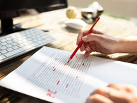 Source: iStock; Copyright: AndreyPopov; URL: https://www.istockphoto.com/photo/person-marking-error-with-red-marker-gm1164644807-320183804; License: Licensed by the authors.