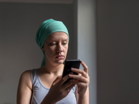 Source: iStock by Getty Images; Copyright: ljubaphoto; URL: https://www.istockphoto.com/ca/photo/woman-using-smartphone-while-fighting-breast-gm878518362-245003735; License: Licensed by the authors.