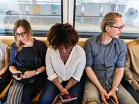 Source: Pexels; Copyright: rawpixel.com; URL: https://www.pexels.com/photo/woman-sitting-holding-smartphone-between-two-men-and-two-women-1083627/; License: Licensed by JMIR.