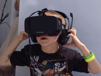 A boy wearing a VR headset. Source: Wikimedia Commons; Copyright: Skydeas; URL: https://commons.wikimedia.org/wiki/File:Boy_wearing_Oculus_Rift_HMD.jpg; License: Creative Commons Attribution (CC-BY).