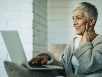 Source: iStock by Getty Images; Copyright: skynesher; URL: https://www.istockphoto.com/photo/happy-senior-woman-using-laptop-while-relaxing-at-home-gm862279014-142865791; License: Licensed by the authors.