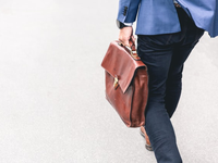 A man walking with his bag, indicating the relevance with the working environment. Walking rhythms could indicate work-related fatigue. Source: Unsplash; Copyright: Marten Bjork; URL: https://unsplash.com/photos/6dW3xyQvcYE; License: Creative Commons Attribution (CC-BY).