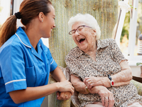 Source: iStock by Getty Images; Copyright: monkeybusinessimages; URL: https://www.istockphoto.com/ca/photo/senior-woman-sitting-in-chair-and-laughing-with-nurse-in-retirement-home-gm1047536650-280201520?irgwc=1&esource=AFF_IS_IR_TinEye_77643&asid=TinEye&cid=IS&utm_medium=affiliate&utm_source=TinEye&utm_content=77643&clickid; License: Licensed by the authors.