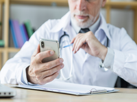 Source: freepik; Copyright: Technology photo created by freepik; URL: https://www.freepik.com/free-photo/crop-doctor-using-smarthone-office_2994311.htm#page=1&query=doctors%20using%20smart%20phone&position=49; License: Licensed by JMIR.
