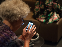 This is a lady using a smartphone App. Source: Flickr; Copyright: ACT Project Concordia; URL: https://www.flickr.com/photos/143297351@N02/28778722244; License: Creative Commons Attribution + Noncommercial (CC-BY-NC).
