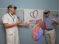 HoloLens use in cardiology. Source: Image created by the Authors; Copyright: Alexander D Hilt; URL: http://humanfactors.jmir.org/2020/2/e17147/; License: Creative Commons Attribution (CC-BY).