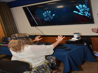 Dr Winkler (Author) demonstrating virtual reality at James A Haley Veterans' Hospital Research Day. Source: Image created by the Authors; Copyright: Dr Sandra L Winkler / The Authors; URL: http://formative.jmir.org/2019/4/e11266/; License: Creative Commons Attribution (CC-BY).