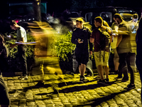 People playing Pokémon GO at night. Source: Flickr; Copyright: Maurice Weststrate; URL: https://flic.kr/p/L4HnTZ; License: Creative Commons Attribution (CC-BY).