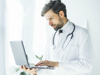Source: Freepik; Copyright: Freepik; URL: https://www.freepik.com/free-photo/serious-young-doctor-browsing-laptop_3004290.htm#page=1&query=search%20hospital&position=2; License: Licensed by JMIR.