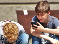 Source: Pexels; Copyright: Pixabay; URL: https://www.pexels.com/photo/2-boy-sitting-on-brown-floor-while-using-their-smartphone-near-woman-siiting-on-bench-using-smartphone-during-daytime-159395/; License: Licensed by the authors.