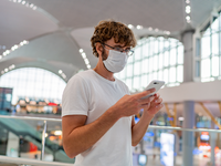Source: Freepik; Copyright: svetlanasokalova; URL: https://www.freepik.com/free-photo/man-wearing-face-protective-medical-mask-using-smartphone_11055089.htm#page=1&query=covid%20smartphone&position=19; License: Licensed by JMIR.
