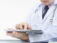 Source: Freepik; Copyright: jcomp; URL: https://www.freepik.com/free-photo/doctor-is-working-with-tablet-white-background_3763235.htm#page=2&query=doctor+computer&position=4; License: Licensed by JMIR.