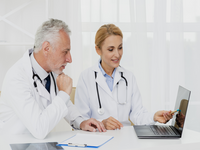 Source: freepik; Copyright: freepik; URL: https://www.freepik.com/free-photo/doctors-looking-laptop-while-sitting_5480800.htm#page=2&query=doctor+with+laptop&position=42; License: Licensed by JMIR.