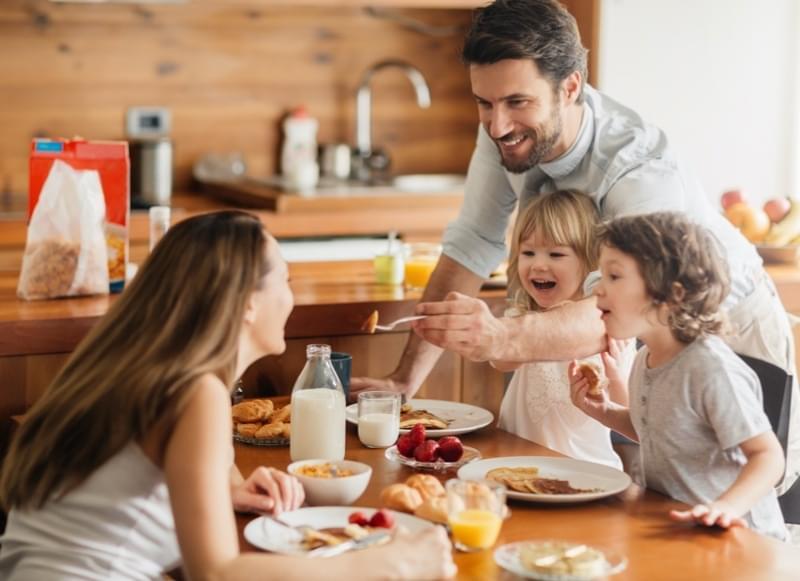 Family of 4 eating breakfast